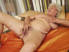 Norma moans loudly while fingering and toying her old hairy pussy