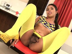 Slender ladyboy in sexy yellow stockings sensually puts on display her tight ass