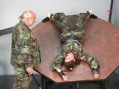 Restrained soldier girl...