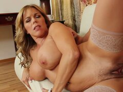 Curvy blonde bitch Amber Lynn Bach rides the cock and gets hammered hard from behind
