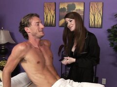 Horny masseuse rubs him up and uses her titties on his willing bone
