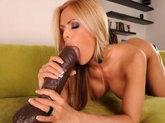 Mouth loaded with huge dildo