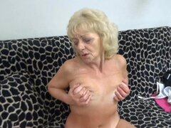 Blonde granny fingers her snatch with gloves on