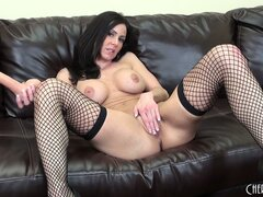 Dazzling brunette milf Kendra Lust shows off her marvelous curvy body on the couch