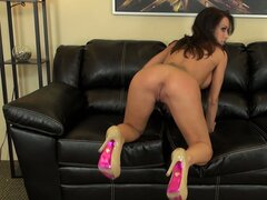 Capri Cavanni oils up her gorgeous tits in the middle of a show