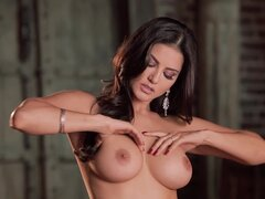 Gorgeous brunette in lingerie Sunny Leon making it solo