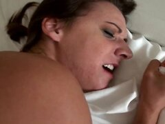 Shy brunette is talked into making a sextape with her man