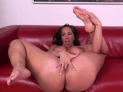 Kelly shows off her ass and spreads her legs wide to finger her twat