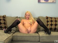 Sweet blonde hottie Aaliyah Love leaves on her sexy stockings and toys her twat