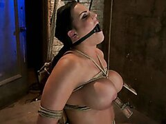 Busty brunette is bound in a chair with a vibrator perfectly stuck on her clit