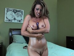 Raquel Devine rubs her mature pussy lips inches from the camera