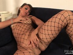 Babe in black fishnets stuffing a pink dildo into her pussy and butt