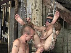He sits in dungeon sex swing and takes a toy