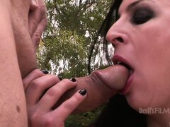 Shemale cheerleader gobbles cock outside and takes it deep throat