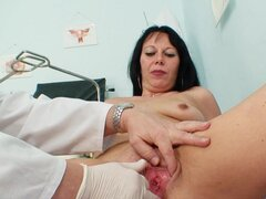 Doctor examines her mature pussy close up