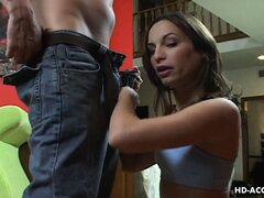 Gorgeous brunette Amber Rayne strips her clothes and gives him a sensual blowjob