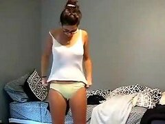 Amateur Girl in Glasses Taking Off Her Robe To Put Her Lingerie On