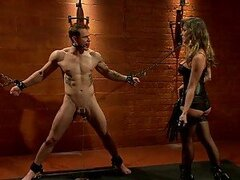 Blonde Dominatrix Ties Up Poor Male Slave