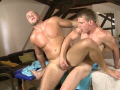 Muscular gay guy fucked on massage table