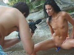 Skinny brunette Ahud enjoys sucking a dick outdoors