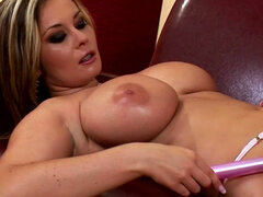 Sexy blonde Constance Devil pokes her vagina with dildo