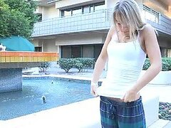 Teen girl Amie is meat-flashing while sitting in the cafe