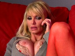 Blonde in red stockings is giving blowjob