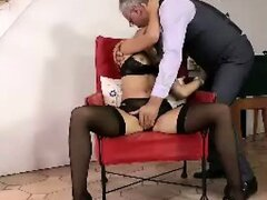 Blonde girl in black stockings fingers pussy for older British man