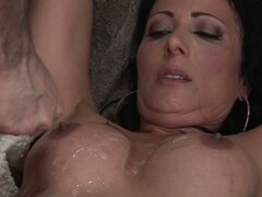 Amazing brunette milf Zoe Holloway rides dick and makes him cum on her tits