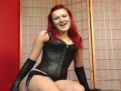 Red haired slut in latex interviewed and teasing hard on cam