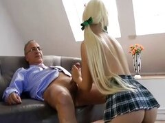 Old man playing with blonde school girl