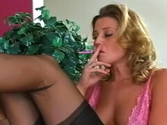 Cute blonde smoke a cigarette in a fetish vid