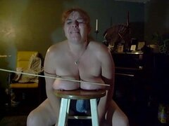 Watch this chubby woman get her huge pierced knockers whipped by a large stick.