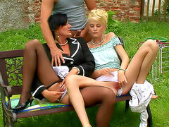 Classy ladies threesome in grass