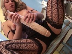 Horny blonde plays with a huge dildo