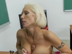 Mature blond hottie Kasey Grant with big fake tits getting fucked in classroom by Rocco Reed in her shaved pussy in a hardcore style after an amazing blowjob service from her