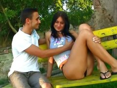 One boy was walking by Alina. She was alone sitting on the bench and her nipples were swollen.