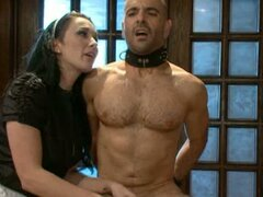 Dominatrix sex, woman is torturing man fucking his ass with strap on dildo