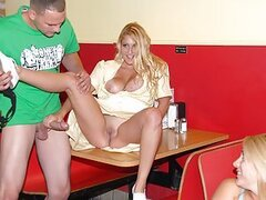 Two young babes, Latina and her busty blonde girlfriend are pleasing 2 guys in caf??. While Latina whore is sucking a big cock, her best mate is being screwed right on the table, without even taking her cloths off, but for the panties removed and dropped