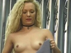 Long haired blonde spreads her pussy for the camera