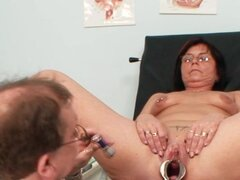 Mature pussy exam and pissing