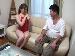This cute Japanese chick is doing her best bay watch impression. Watch her slip out of this red swimsuit.