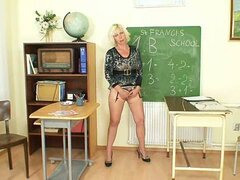 Horny matured blonde teacher in stockings fingers at the classroom
