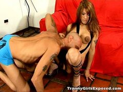 Busty tranny hooker Morena riding anally a massive penis on the couch