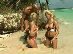 Busty and Not-So-Busty Blondes Swap a Cock In FFM Threesome at the Beach