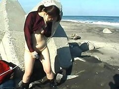 Japanese Mature Takes A Piss After Masturbating On A Beach