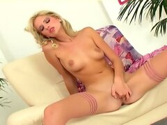Petite blonde masturbates in stockings and heels