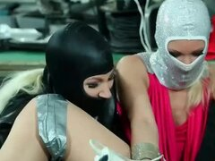 Masked women vigorously masturbate a girl