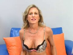 A randy little granny slut is on her knees and devouring a stud's dick
