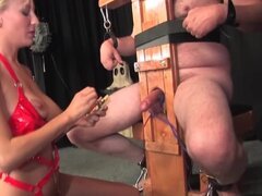 Hooded man in wild bondage takes CBT